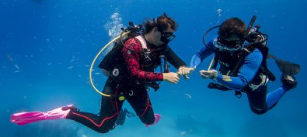 beginner scuba diver and instructor